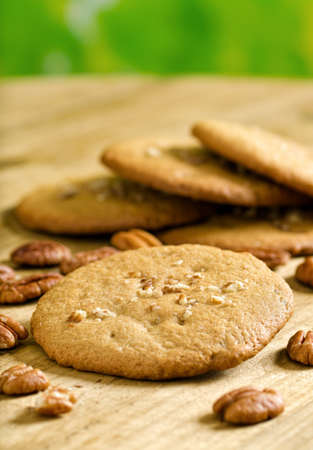whole pecans: A stack of freshly baked pecan cookies with whole pecans.