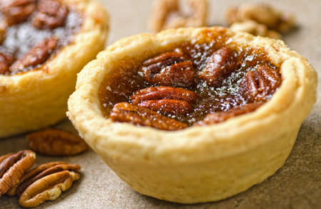 pecan: Pecan butter tarts with whole pecans.