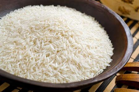basmati: A bowl of long grain basmati rice.