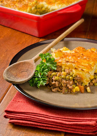 A hot and hearty shepherds pie with cheddar cheese.