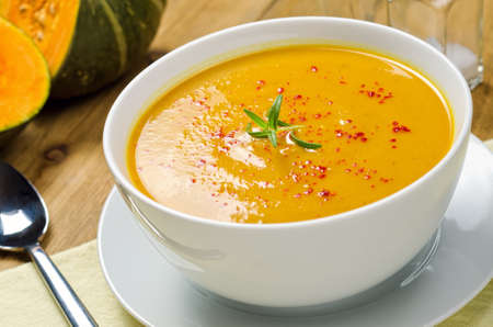pumpkin soup: A hot bowl of creamy squash soup with rosemary and paprika. Stock Photo