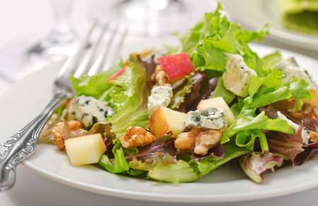 salad fork: Waldorf salad with greens, apples, walnuts, and blue cheese. Stock Photo