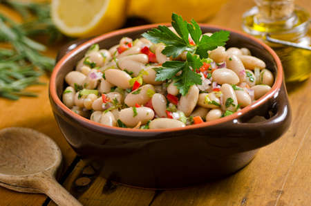 A hearty rustic white bean cannellini salad with olive oil and lemon.