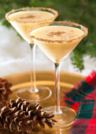 eggnog: Two delicious eggnog martinis with brown sugar rimmer and cinnamon sprinkle.