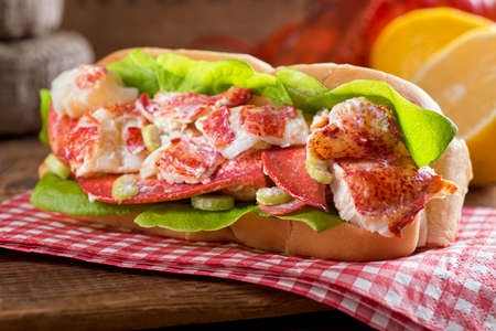lobster dinner: A delicious freshly made lobster roll with lobster, lemon, celery, and mayonnaise.