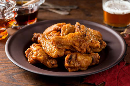 A plate of delicious chicken wings.