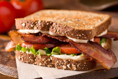lettuce: A delicious bacon, lettuce, and tomato blt sandwich. Stock Photo
