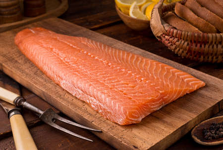 A delicious salmon fillet on a cedar plank. Stock Photo