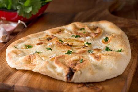 A delicious homemade garlic naan flatbread with garlic butter and cilantro.