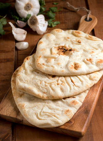 Delicious fresh homemade naan bread with garlic and cilantro. photo