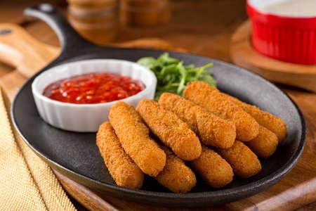 Delicious breaded mozzarella cheese sticks with marinara dipping sauce.