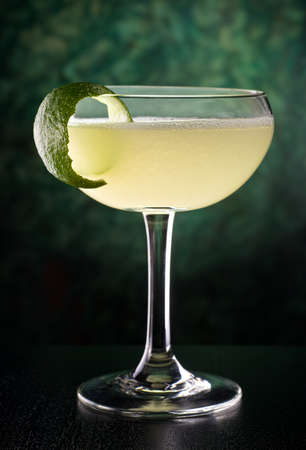 limes: A delicious classic style daiquiri with rum, lime juice, and sugar. Stock Photo