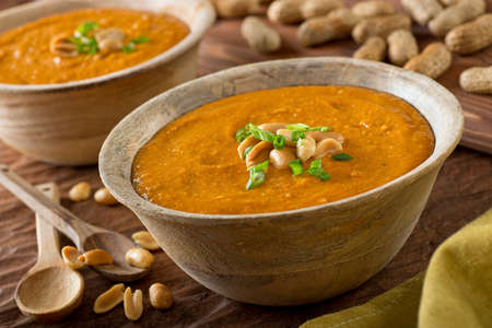 A delicious bowl of homemade african peanut soup with green onion garnish.
