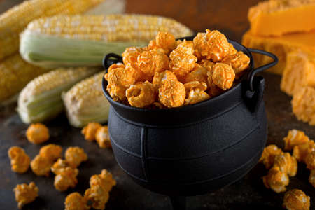 pop corn: Delicious homemade cheddar cheese kettle corn popcorn. Stock Photo