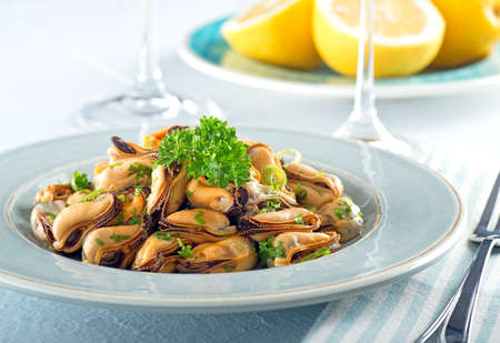 seafood salad: A delicious blue mussel salad with green onions and parsley.