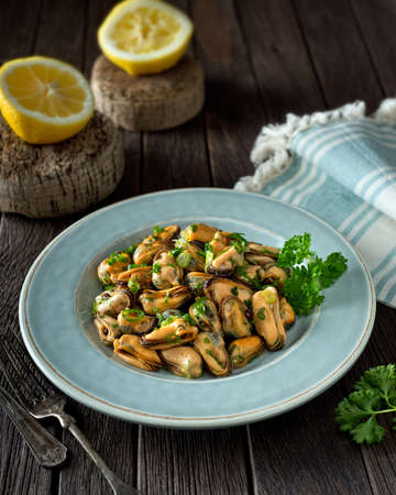 blue sea: A delicious blue mussel salad with green onion and parsley. Stock Photo