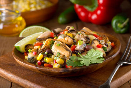 black beans: A delicious mexican style mussel salad with black beans, cilantro, red pepper, jalapeno, and corn. Stock Photo