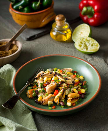 red jalapeno: A delicious mexican style mussel salad with black beans, cilantro, red pepper, jalapeno, and corn. Stock Photo