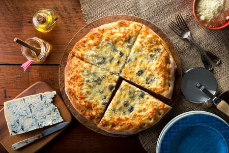 gourmet pizza: A delicious home made gourmet pizza with gorgonzola blue cheese.