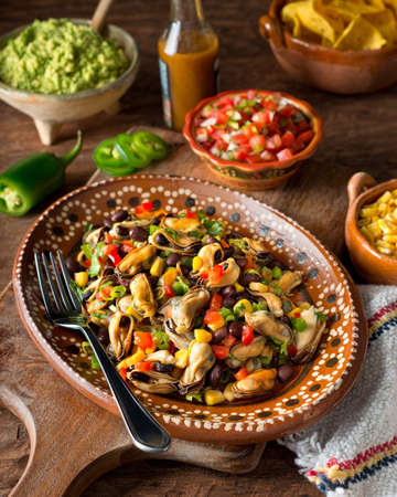 red jalapeno: A delicious mexican mussel salad ceviche with red pepper, corn, black beans, green onion, cilantro, and jalapeno pepper.