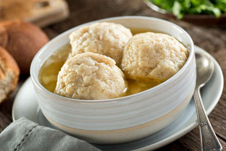A bowl of delicious homemade authentic matzo ball soup.