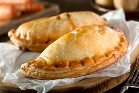crimped: Delicious homemade Cornish pasties with beef, carrot, and potato.