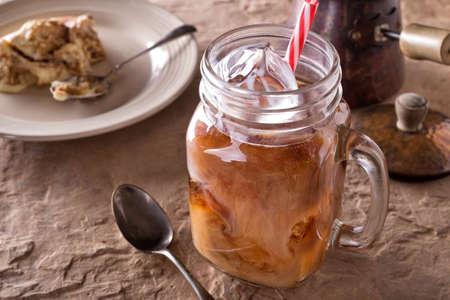 A glass of delicious iced coffee with tiramisu.
