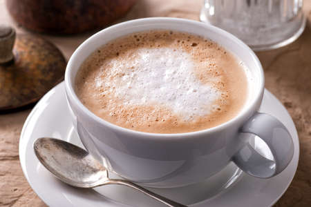 A cup of delicious hot and foamy cafe latte.