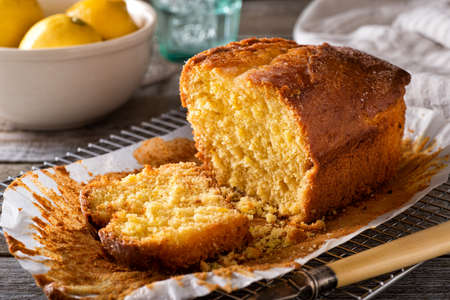 A delicious homemade lemon loaf on a rustic table top. 스톡 콘텐츠