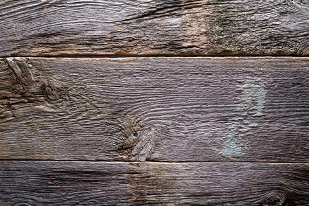 Rustic wood weathered gray barn board background texture.