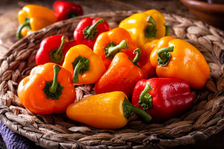 A basket of fresh colorful bell peppers.