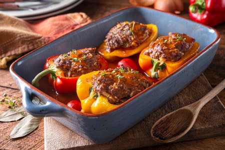 Delicious homemade stuffed peppers in savory tomato sauce. 스톡 콘텐츠 - 143799373
