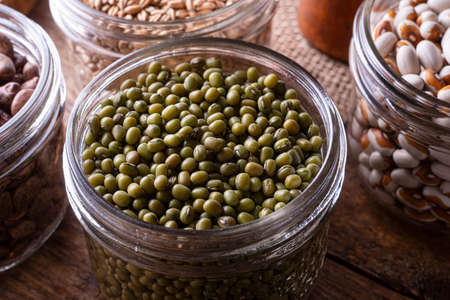 Green mung beans in a glass storage container. 스톡 콘텐츠 - 146007400