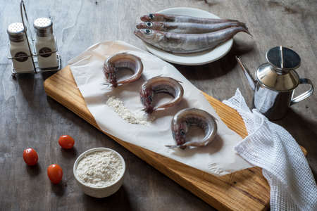 Blue whiting or lilies, fish on the table prepared to be cleaned and cooked in different ways, battered, baked, pickled. Tasty and healthy seasonal white fish. Stock fotó