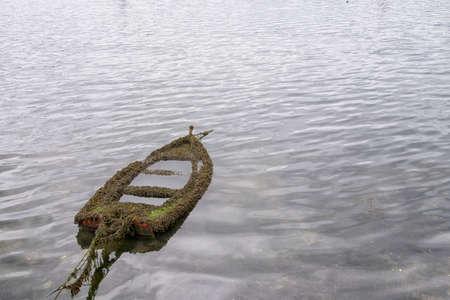 Semi-sunken boat in the ria de Pontevedra in Combarro, a parish belonging to the municipality of Poio in Pontevedra, Galicia, Spain, Europe.