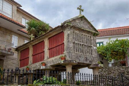 Ancient horreo in Combarro, a parish belonging to the municipality of Poio in Pontevedra, Galicia, Spain, Europe. Фото со стока