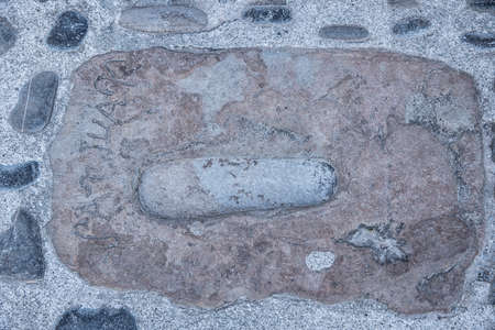 Footprint of San Juan in the cement in the hermitage of San Juan de Gaztelugatxe located on an islet in Bermeo, Biscay, Basque Country, Spain, Europe