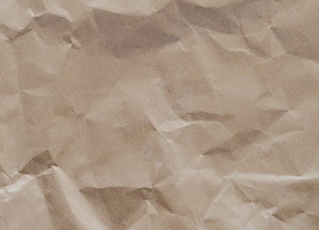 parch: creased paper texture - brown paper sheet.