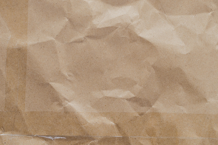 creased: creased paper texture - brown paper sheet.