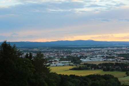budejovice: Panoramatic view on city Ceske Budejovice in sunset with trees