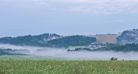 budejovice: Meadow and vilage in morning fog, Czech landscape