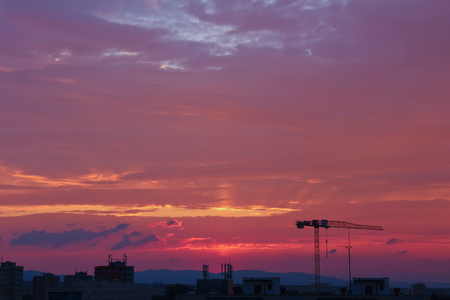budejovice: Crane silhouette in violet sunset sky in city Ceske Budejovice