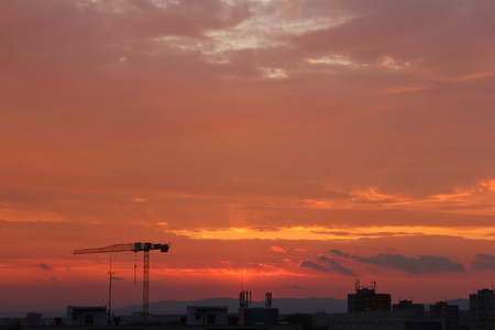 budejovice: Ceske Budejovice with crane silhouette in orange sunset sky