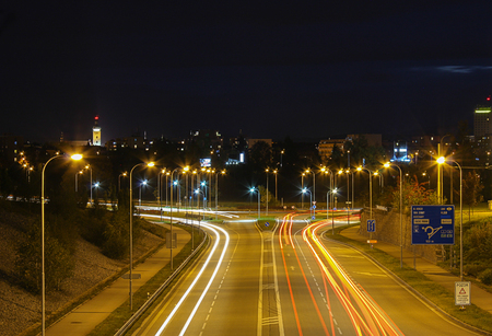 budejovice: Street and car at night on long exposure with Ceske Budejovice in background Stock Photo