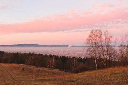 Amazing winter sunrise over city Ceske Budejovice and hill Klet, Czech landscape