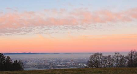 Amazing winter sunrise over city Ceske Budejovice with meadow, Czech landscape