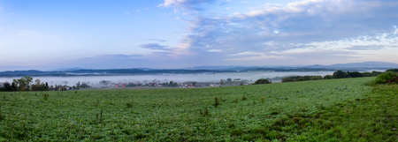 Panoramatic view to small village in morning fog, Czech landscape