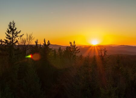 Sunset on lookout Nebelstein with trees, Austria landscape