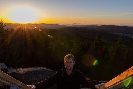 Portrait of young man walk up on stair with sunset, Austria landscape Reklamní fotografie