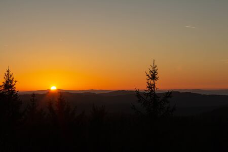 Nice sunset on lookout Nebelstein with trees and distant hill, Austria landscape Reklamní fotografie